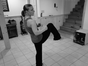 Start in a fighting stance again. Pretend as though you are grasping someone's shoulders in front of you and dragging them down to your knee while thrusting your right knee upward. Do two knee strikes, then switch to the other leg.